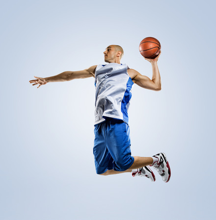 Photo pour Basketball player in action isolated on white background - image libre de droit