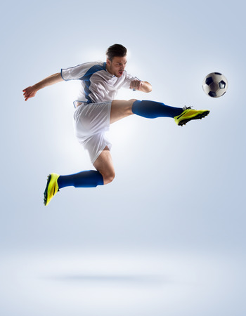 Photo pour football soccer player in action  isolated on color background - image libre de droit