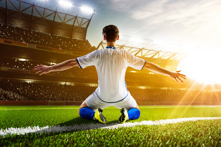 Photo pour Soccer player in action on night stadium background - image libre de droit