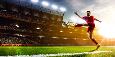 Photo pour Soccer player in action on night stadium background panorama - image libre de droit