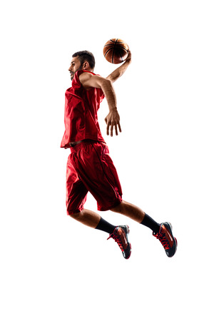 Foto de Isolated on white basketball player in action is flying high - Imagen libre de derechos