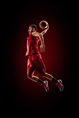 Photo pour Isolated on black basketball player in action is flying high - image libre de droit