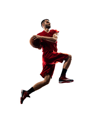 Photo pour basketball player in action Isolated on white - image libre de droit