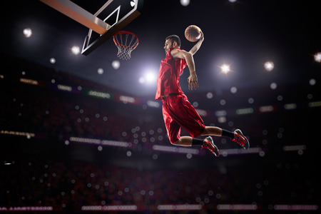 Photo pour red Basketball player in action in gym - image libre de droit