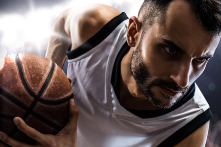 Foto de basketball player in action Isolated on black  - Imagen libre de derechos