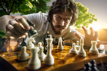 Photo for Very serious man is playing the chess - Royalty Free Image