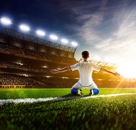 Photo pour Soccer player in action on night stadium panorama background - image libre de droit