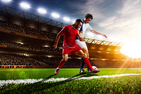 Photo pour Soccer players in action on sunset stadium background panorama - image libre de droit