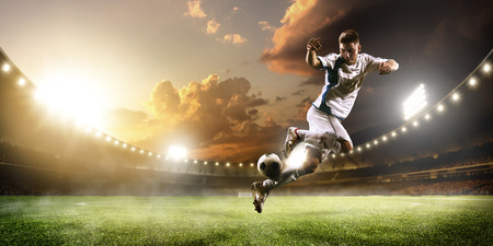 Photo pour Soccer player in action on sunset stadium background - image libre de droit