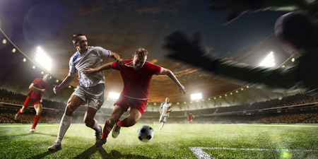 Photo for Soccer players in action on the sunset stadium background panorama - Royalty Free Image