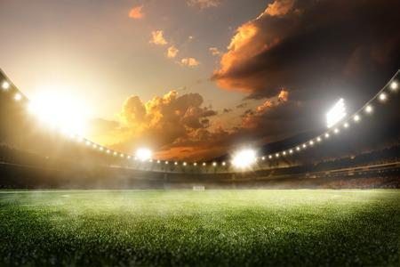 Photo pour Empty sunset grand soccer arena in the lights - image libre de droit