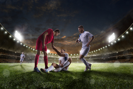 Photo pour Soccer players in action on the sunset stadium background panorama - image libre de droit
