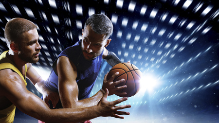 Photo pour Streetball players in action on night court - image libre de droit