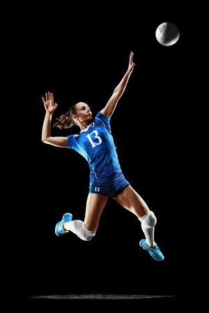 Foto de Female professional volleyball player isolated on black - Imagen libre de derechos