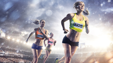 Foto de Three professional female runners at grand arena - Imagen libre de derechos