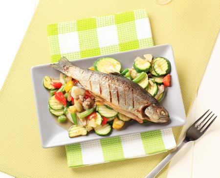 Grilled trout served with mixed vegetables
