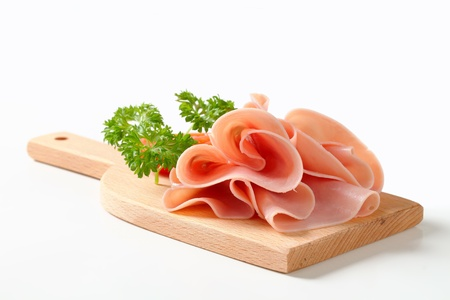 Photo for Thinly sliced ham on cutting board - Royalty Free Image