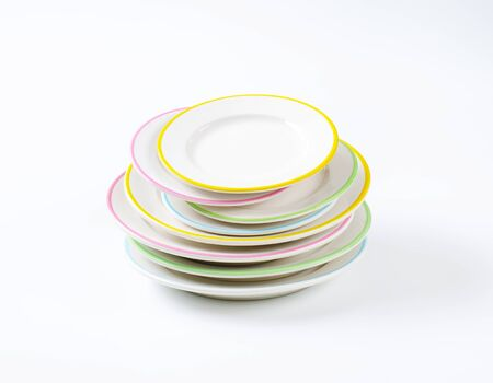 Photo pour stack of rimmed plates on white background - image libre de droit
