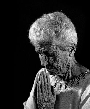 Senior Citizen in Deep Prayer in Monochrome