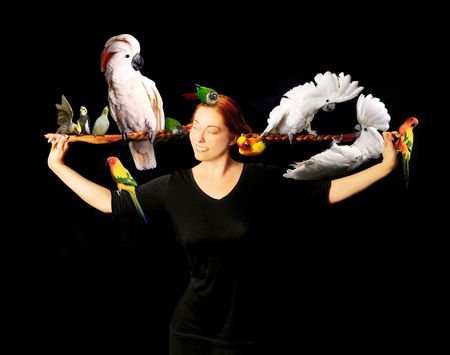 Woman Who Has Multiple Exotic Birds in Her Very Long Red Hair