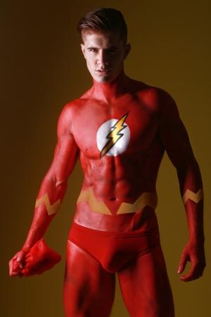 Photo pour Red Body Painted Man as Fantasy Generic Superhero   - image libre de droit