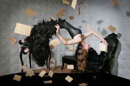 Foto de Levitation shot of a Woman and Her Favorite Book - Imagen libre de derechos