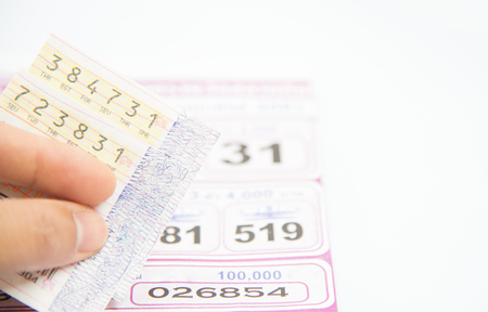 Foto de Checking thai lottery in jackpot on white background. - Imagen libre de derechos