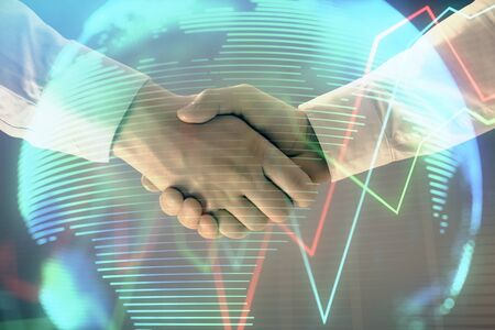 Foto de Multi exposure of forex graph and world map on abstract background with two businessmen handshake. Concept of success on international markets - Imagen libre de derechos