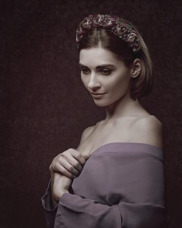Foto de Beautiful young woman. Female portrait with traditional folk crown on his head - Imagen libre de derechos