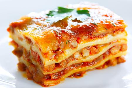 Foto de A piece of lasagna on a white plate large - Imagen libre de derechos