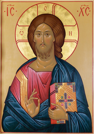 Foto de Image of Christ with the gospel and the hand of blessing on the ancient Russian icon - Imagen libre de derechos
