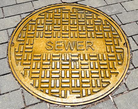 Photo pour The word sewer on the hatch cover - image libre de droit