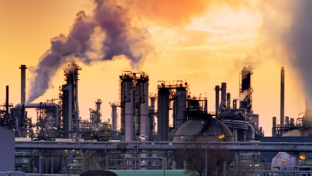 Photo pour Smokestack in factory with yellow sky and clouds  - image libre de droit