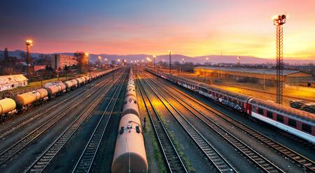 Photo pour Cargo freigt train railroad station at dusk  - image libre de droit