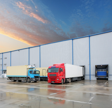Photo for Cargo truck at warehouse building - Royalty Free Image