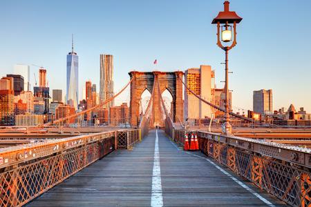 Foto de New York City Brooklyn Bridge in Manhattan closeup with skyscrapers and city skyline over Hudson River. - Imagen libre de derechos