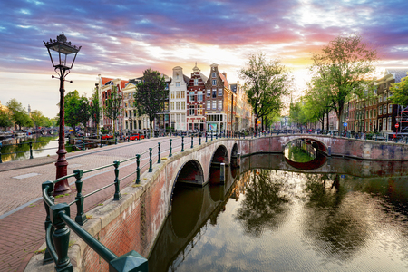 Photo pour Amsterdam Canal houses at sunset reflections, Netherlands - image libre de droit