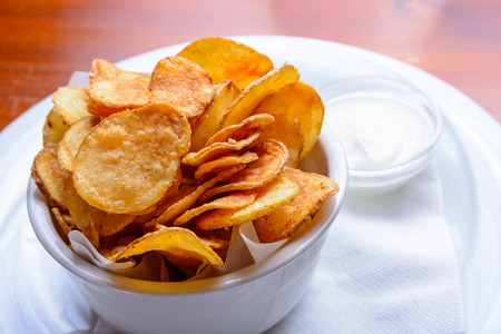 Photo for Homemade potato chips with dip - Royalty Free Image