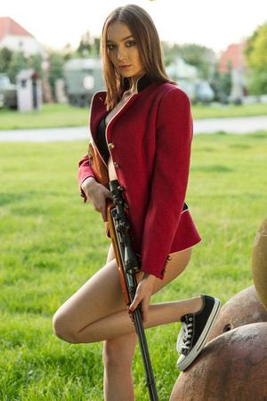 Photo pour Soldier woman in the red jacket and lingerie - image libre de droit
