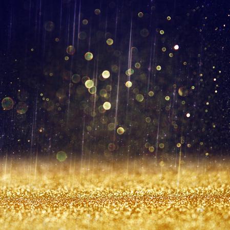 Photo pour glitter vintage lights background  light gold and black  defocused    - image libre de droit