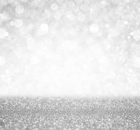 Foto de silver and white bokeh lights defocused  abstract background - Imagen libre de derechos