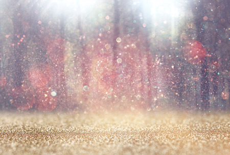 Photo pour blurred abstract photo of light burst among trees and glitter bokeh lights. filtered image and textured. - image libre de droit