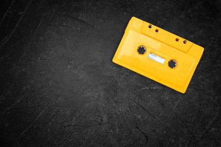 Photo pour yellow retro Cassette tape over blackboard. top view. - image libre de droit