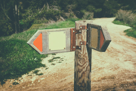 Photo pour signpost in countryside landscape. image is retro filtered with faded style . - image libre de droit