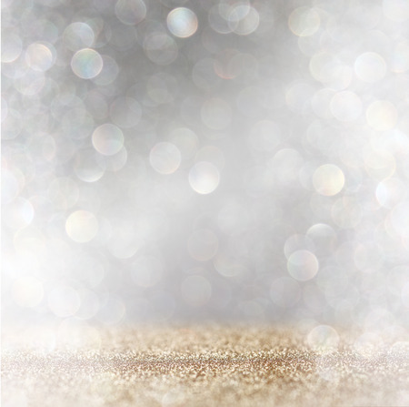 Photo for abstract image of glitter vintage lights background with light burst . silver, gold and white. de-focused. - Royalty Free Image