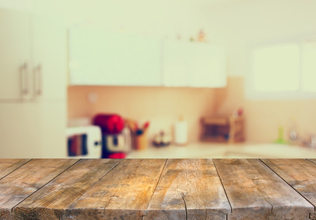 empty table board and defocused white retro kitchen background