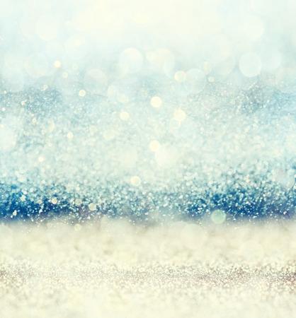 Foto de glitter vintage lights background with light burst . gold blue and white. defocused. - Imagen libre de derechos