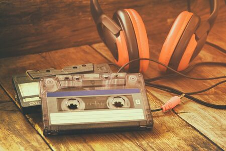 Photo for selective focus of Cassette tape over wooden table. image is instagram style filtered. - Royalty Free Image