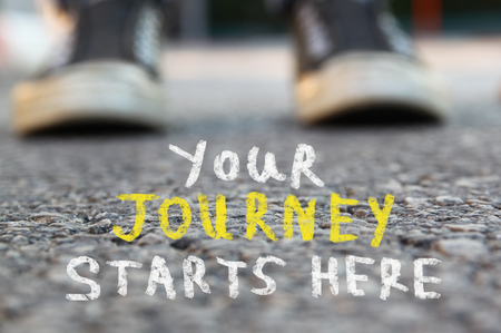 Photo for image with selective focus over asphalt road and person with handwritten text - your journey starts here. education and motivation concept - Royalty Free Image