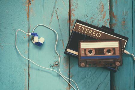 Photo pour Cassette and old tape player over wooden background. retro filter - image libre de droit
